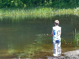 Boy Fishing in the Creek at Crown Point